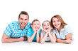 Caucasian happy smiling young family with two children