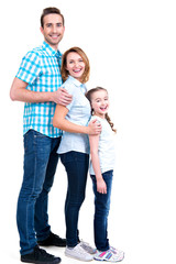 Full portrait of the happy european family with child
