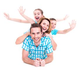 Young happy family with raised hands up