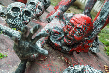 The sculpture in the mock up hell in the temple in Thailand.