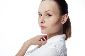 Beautiful business woman in a white shirt, hair in a ponytail on