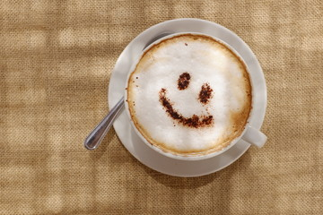 Coffee cappuccino with foam or chocolate smiling face