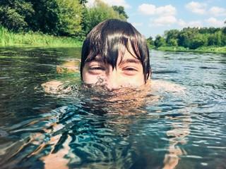 Young boy splashing in the water
