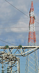 red pylon of the high voltage electric cables in power station