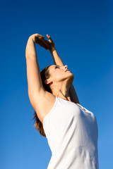 Female athlete stretching arms for exercising and relax