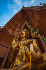 Big golden buddha statue in Tiger Cave Temple
