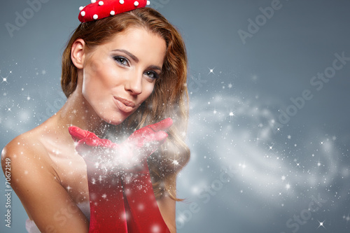 canvas print picture Beautiful  woman in Santa Claus clothes with gift