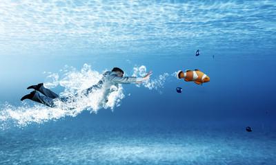 Swimming businessman