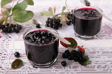 Glasses with black chokeberry jam