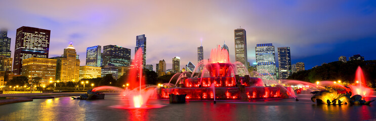 Chicago skyline panorama with Buckingham fountain at night, USA