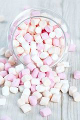 marshmallows in beautiful glass dish on a wooden table