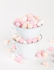 marshmallow in  stacked cups isolated on white