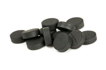 black pills isolated on white