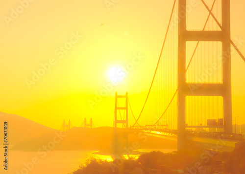 Tsing Ma Bridge in Hong Kong with the sunshine in soft focus