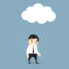Businessman  standing in the rain under a cloud