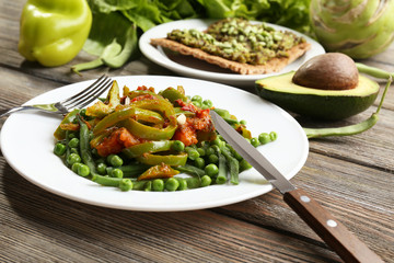 Healthy salad with peas and asparagus served
