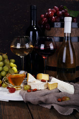 Supper consisting of Camembert and Brie cheese, honey, wine and
