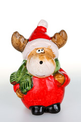 Christmas figurines,reindeer with Santa clause outfit.
