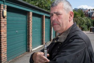 Middle-aged man smoking an e-cigarette