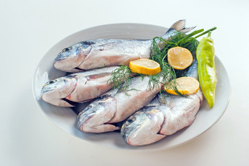 Fresh fishes with vegetables and lemon