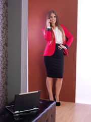 Business woman talking on the mobile.