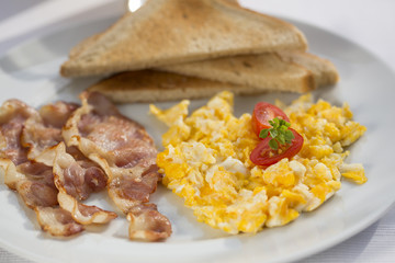 Sunny Breakfast with bacon, eggs and bread.