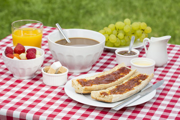 Breakfast with bread, fruits and hot chocolate