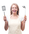 Beautiful housewife with ladle and spatula. Isolated on white ba