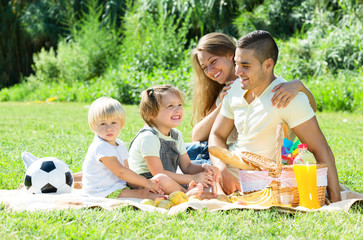 European family with children having picnic
