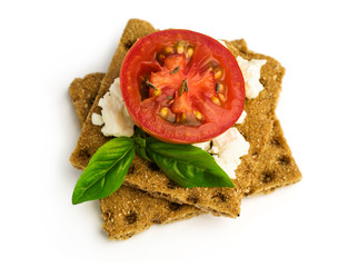rye bread with cheese, tomatoes, basil and thyme