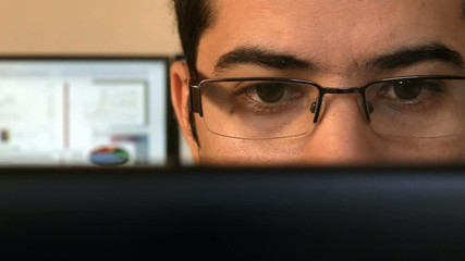 Close up of a young business man at the office.