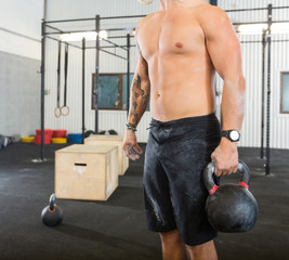 Male Athlete Carrying Kettlebell