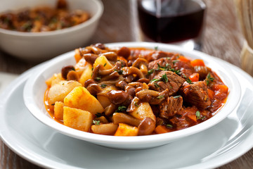 Hot stew with mushrooms and potatoes