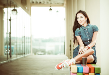 smiling brunet at colorful city bench