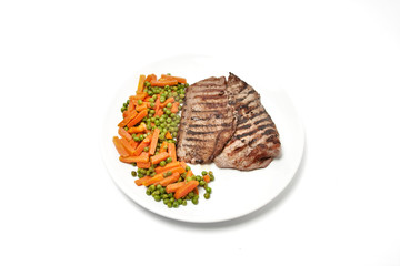 Grilled beef steak served with vegetables