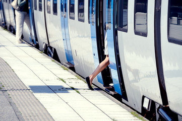 Woman enters train, only ankle seen