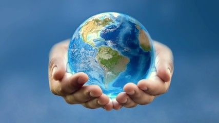 Earth in man's hands – blue background