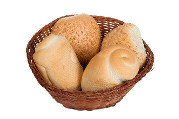 bread in a wicker basket isolated on white background