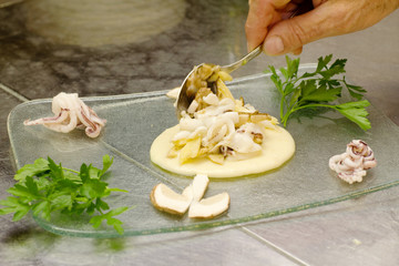 chef recipe with small octopus, mashed potato and raw boletus
