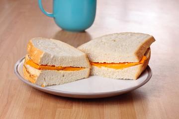Cheese sandwich and mug