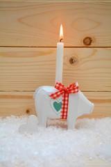 Glücksschwein mit Kerze