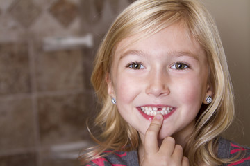 Child missing front tooth