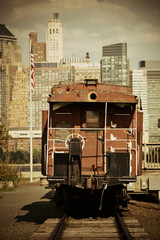 Train and downtown Manhattan in park.
