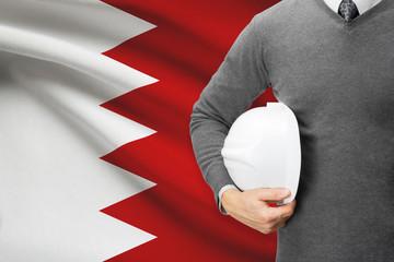 Architect with flag on background  - Bahrain