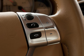 Buttons on steering wheel. Car interior detail.