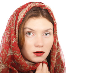 Woman beauty face in red silk head scarf