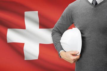 Architect with flag on background  - Switzerland
