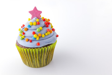cupcake with blueberry frosting and colorful sprinkles