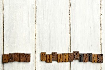 Happy Thanksgiving wood letters on white wood background