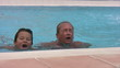 Mother and son playing in the swimming pool